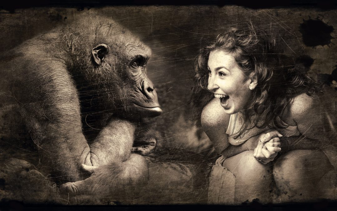 Girl showing excitement at seeing ape