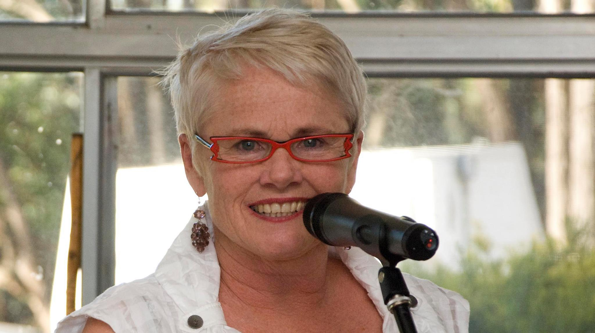 Noelene Gration with Microphone Public Speaking